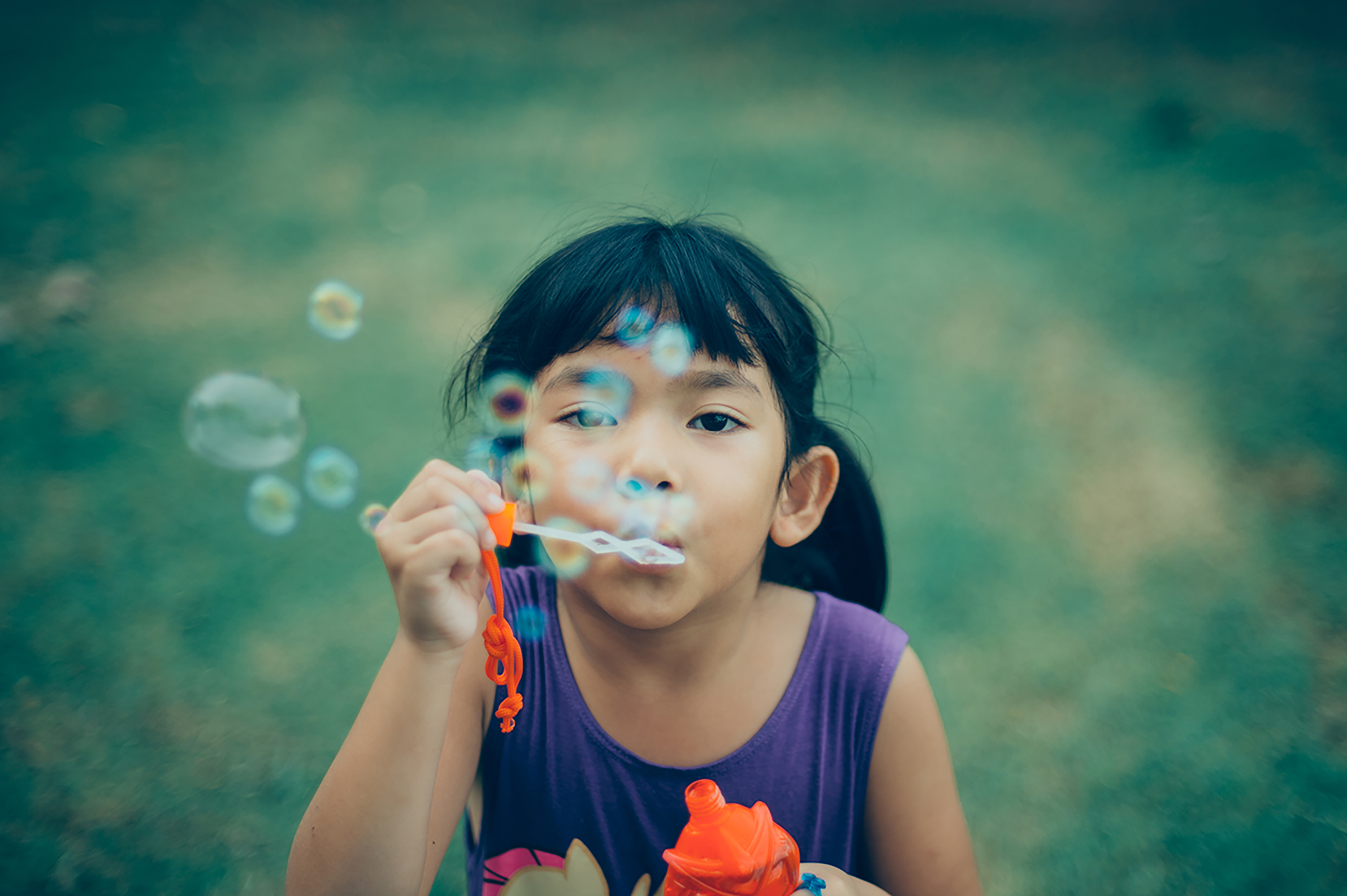Asian little girl happy with water bubble